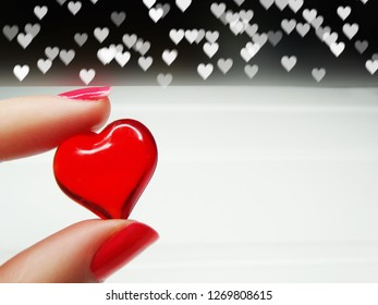woman's hand with heart love valentine's day on bokeh blurs shiny background greeting card