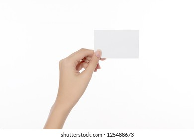 Woman's hand holding blank card