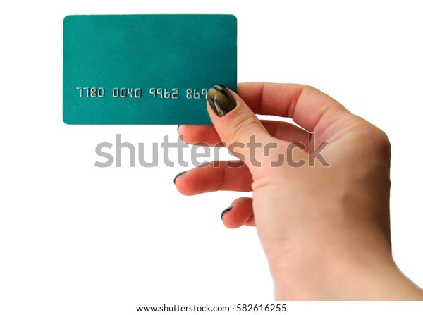 Woman's hand holding blue blank plastic credit card, isolated on white.