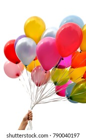 woman's hand holding bunch of multicolored balloons in the city festival , vertical composition,isolated on white background