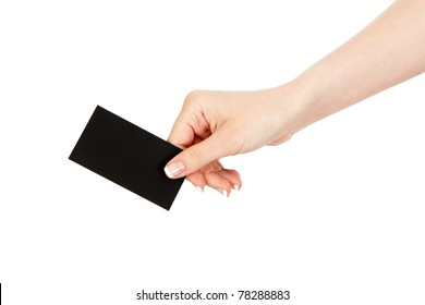 woman's hand holding a business card