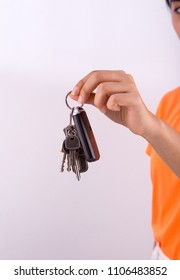 Woman's hand holding car keys