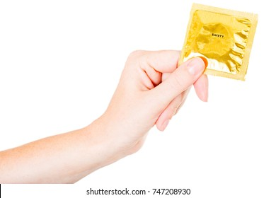 woman`s hand holding a condom package, isolate on white background