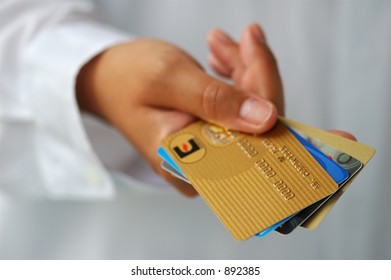 Woman's Hand Holding Credit Cards