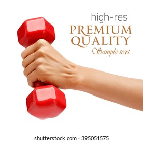 Woman's hand holding dumbbell isolated on white background. Close up, concept of healthy lifestyle