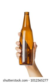 Woman's hand holding empty beer bottle transparent on white background, File contains a clipping path.