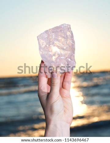 Womans hand holding gem