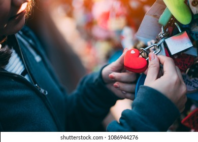 Woman's hand holding The Love Key Ceremony on N Seoul Tower at Namsan Mountain in Seoul City, South Korea.