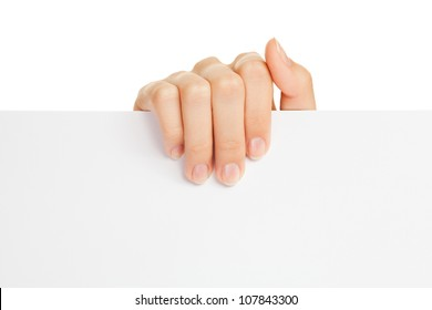 Woman's hand holding paper on white background