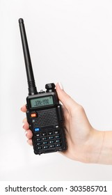 Woman's hand holding portable walkie-talkie