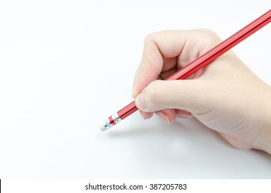 Woman's hand holding with red pencil Eraser on white background