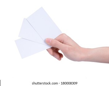 A woman's hand holding three cards