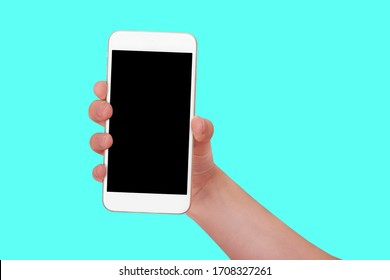 A woman's hand holds a white smartphone with a black screen. Layout for the text. Isolate on a colored background. Blank for the design.