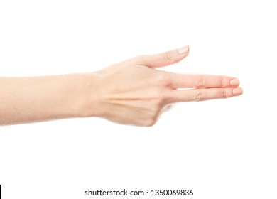 Woman's hand making shooting gun, gesture. hand pistol gesture on isolated white background. Woman hand pointing  with two fingers