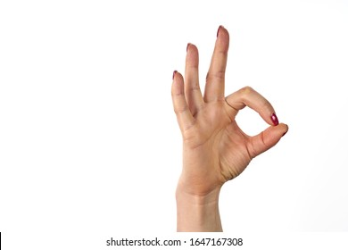 Womans hand ok sign on white background.