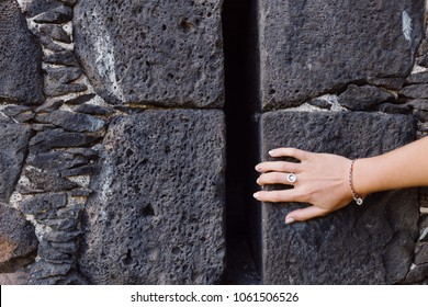 Woman's hand on the stone wall