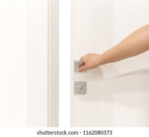 Woman's hand opening door with white background for your design