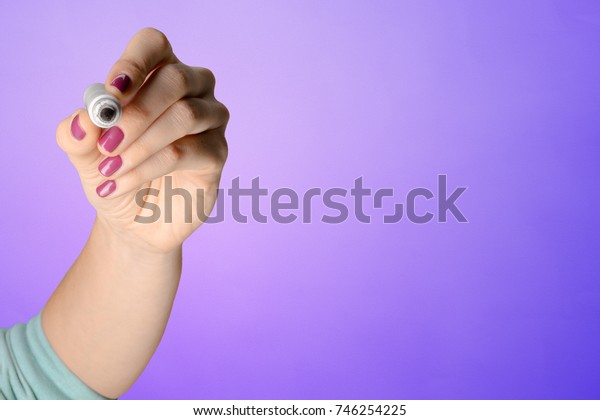 Woman's hand with a pencil