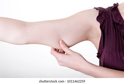 womans hand pinching in upper arm