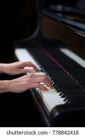A woman's hand playing the piano
