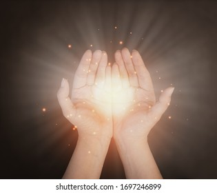 Woman's hand praying and worship to GOD Using hands to pray in religious beliefs and worship christian in the church or in general locations in vintage color tone or copy space.