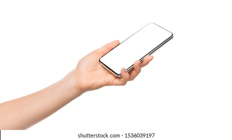 Woman's hand presenting modern smartphone with blank screen, isolated over white background, panorama