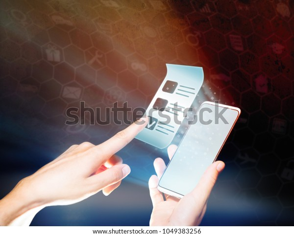 Woman's hand the pressing on the questionnaire icon. Concept of online testing, questionnaires, voting.