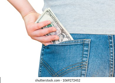 Womans hand is putting dollar money in jeans pocket isolated on white background