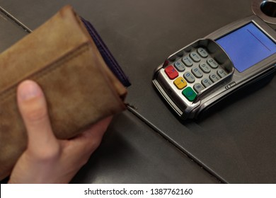woman's hand ready to pay at terminal point of sale tpv