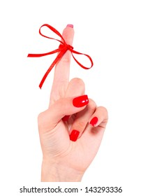 Woman's hand with red ribbon on your finger, concepts sclerosis