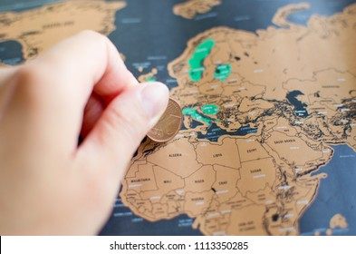Woman's hand is scratching a scratch map