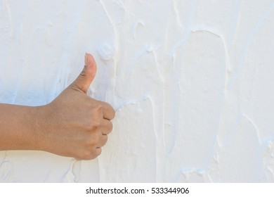 woman's hand showing one or like count isolated on  white cement wall background