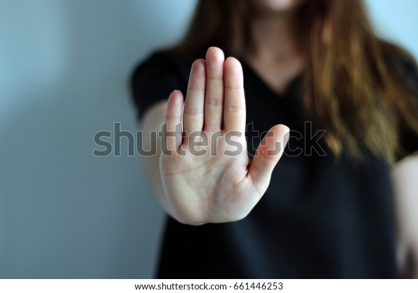 Woman's hand showing reject or stop