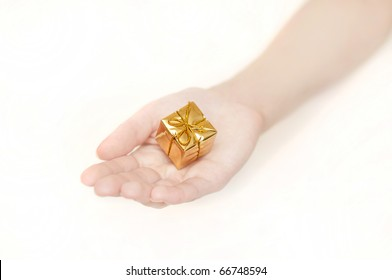 woman's hand with a small yellow gift