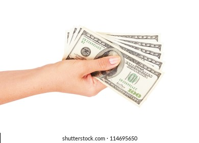Woman's hand with stack of dollars isolated on white