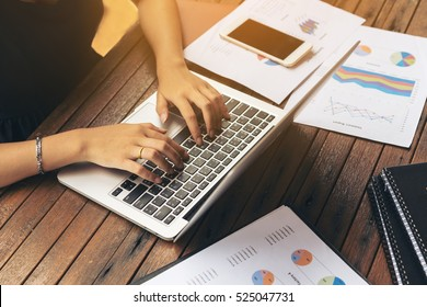 Woman's hand typing on laptop computer.