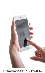 Woman's hand using mobile smart phone on white background .soft focus