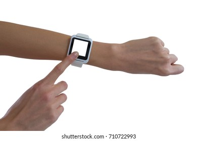 Womans hand using smart watch against white background