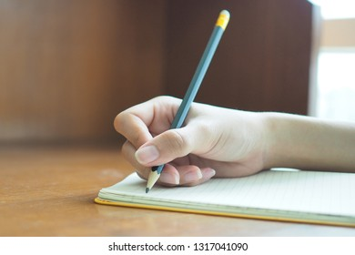Woman's hand is writing
