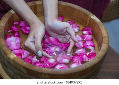 Woman's hands in bowl of water hand spa concept