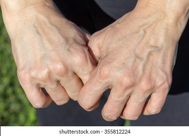 a woman's hands in bright sunlight
