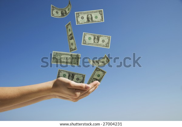 Woman's hands catching money