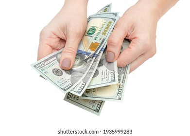 Woman's hands counting money. Isolated on white.