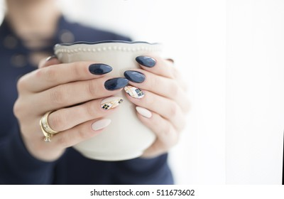 woman's hands with a cup of hot drink