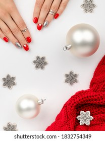 Womans hands with fashionable red manicure with ornaments on white background.. Christmas new year nail design. Manicure, pedicure beauty salon concept.