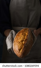 Woman's hands with fresh homemade bread.