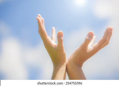 Woman's hands greeting the sun
