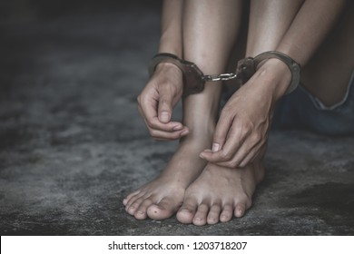 Woman's hands in handcuffs, Stop violence against Women,  human trafficking Concept, international women's day.