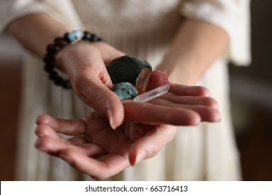 Woman's hands holding crystals.