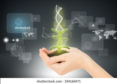 Womans hands holding plant with ground and DNA on abstract background
